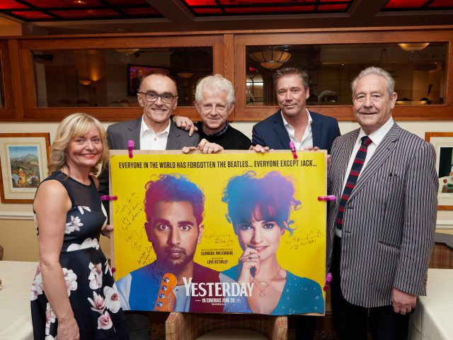 Margaret Goss, manager of the Pier Hotel, with co-owners Rodney Scott and Ian Scott, and film director Danny Boyle and scriptwriter Richard Curtis.
